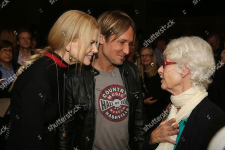 """From left, actress Nichole Kidman and artist Keith Urban talk with veteran female music executive and long-time believer in Urban, Mary Martin, at the opening of the """"Keith Urban So Far..."""" exhibit at the Country Music Hall of Fame and Museum on in Nashville, Tenn"""