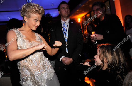 """Stock Image of Julianne Hough, left, dances with fellow """"Safe Haven"""" cast member Mimi Kirkland at the post-premiere party for the film on in the Hollywood section of Los Angeles"""