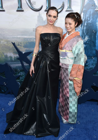 """Angelina Jolie, left, and Aya Ueto arrive at the world premiere of """"Maleficent"""" at the El Capitan Theatre, in Los Angeles"""