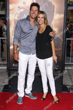"""From left, actor Michael Trucco and wife / actress Sandra Hess arrive at the world premiere of """"Riddick"""" at the Mann Village Westwood Theater on in Los Angeles"""