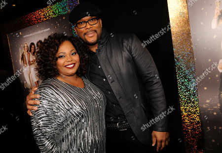 """Cocoa Brown, left, and Tyler Perry arrive at the world premiere of """"The Single Moms Club"""",, in Los Angeles"""