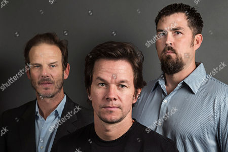From Universal's upcoming film, 'Lone Survivor', left, Director Peter Berg, center, actor, Mark Wahlberg and former Navy SEAL and author of the book 'Lone Surivivor,' Marcus Luttrell, right, pose for a portrait, on in New York