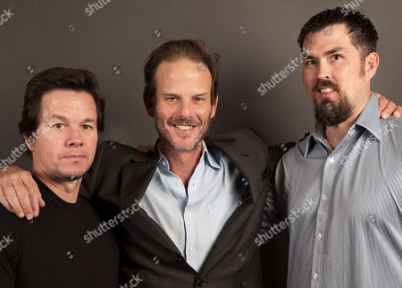 """From Universal's upcoming film, """"Lone Survivor"""", actor Mark Wahlberg, left, Director Peter Berg, center, and former Navy SEAL and author of the book """"Lone Surivivor,"""" Marcus Luttrell, right, pose for a portrait, on in New York"""