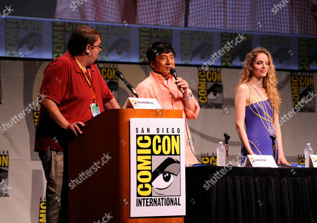 Actor Jackie Chan, center, speaks next to actor Laura Weissbecker, right, and moderator Drew McWeeney, left, during a panel at the Comic-Con convention held at the San Diego Convention Center, in San Diego