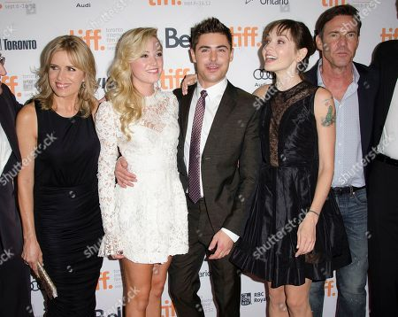 """Stock Photo of From left, actors Kim Dickens, Maika Monroe, Zac Efron, writer Hallie Elizabeth Newton, and actor Dennis Quaid attend the """"At Any Price"""" premiere during the Toronto International Film Festival, in Toronto"""