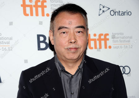 "Chinese director Chen Kaige arrives at the premiere for ""Caught In The Web"" during the Toronto International Film Festival on in Toronto"