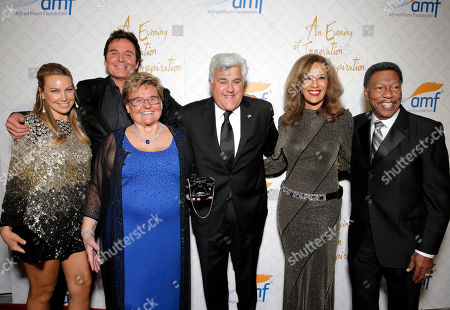 Stock Image of From left, Cassandra Mann, Jeff Tracta, Claudia Mann, Jay Leno, Marilyn McCoo and Billy Davis, Jr. arrive at the 10th annual Alfred Mann Foundation Gala, in Beverly Hills, Calif