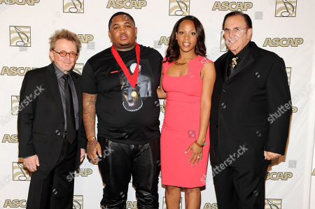 From left, ASCAP President Paul Williams, DJ Mustard, Nicole George-Middleton, Vice President of ASCAP Rhythm & Soul/Urban Membership, and ASCAP CEO John LoFrumento pose backstage at the 26th Annual ASCAP Rhythm & Soul Music Awards, in Beverly Hills, Calif