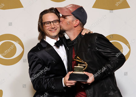 """Stock Picture of Josh Kear, left, and Chris Tompkins pose backstage with the award for best country song for """"Blown Away"""" at the 55th annual Grammy Awards, in Los Angeles"""