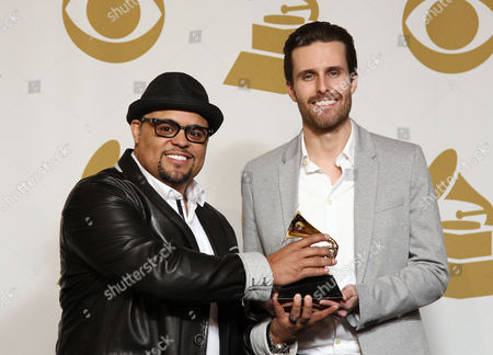 """Israel Houghton, left, and Micah Massey pose backstage with the best contemporary Christian music song award for """"Your Presence is Heaven"""" at the 55th annual Grammy Awards, in Los Angeles"""