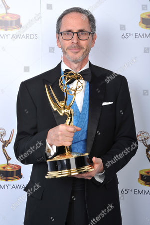 Keith Ian Raywood poses for a portrait at the 2013 Primetime Creative Arts Emmy Awards, on at Nokia Theatre L.A. Live, in Los Angeles, Calif