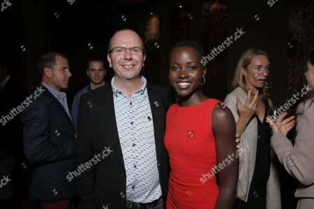 IMDB's Col Needham and Lupita Nyong'o attends Fox Searchlight's Toronto International Film Festival Party on Saturday, September 7th, 2013 in Toronto, Canada