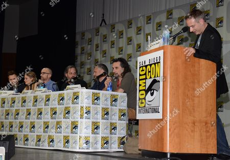 """Joel McHale and from left, Gillian Jacobs, Jim Rash, Dan Harmon, Chris McKenna, Dino Stamatopoulos and Harmon, Chris McKenna, Dino Stamatopoulos, Michael Schneider attend the """"Community"""" panel on Day 1 of Comic-Con International, in San Diego"""