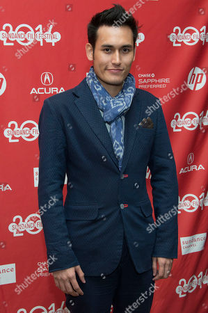 "Actor Arifin Putra poses at the premiere of the film ""The Raid 2"" during the 2014 Sundance Film Festival,, in Park City, Utah"