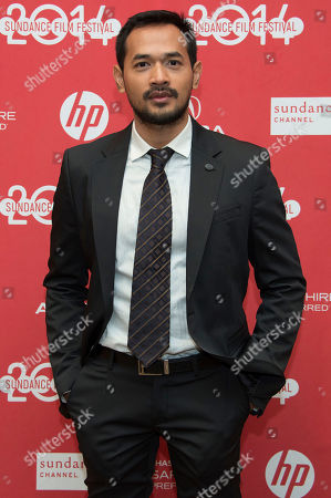 """Stock Image of Actor Donny Alamsyah poses at the premiere of the film """"The Raid 2"""" during the 2014 Sundance Film Festival,, in Park City, Utah"""