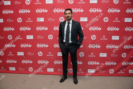 """Stock Photo of Actor Donny Alamsyah poses at the premiere of the film """"The Raid 2"""" during the 2014 Sundance Film Festival,, in Park City, Utah"""