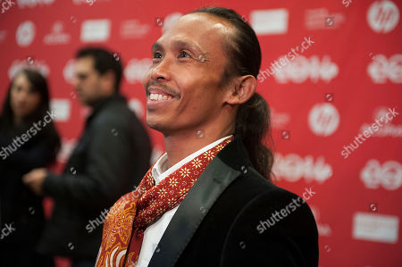 "Stock Photo of Actor Yayan Ruhian speaks during an interview at the premiere of the film ""The Raid 2"" during the 2014 Sundance Film Festival,, in Park City, Utah"