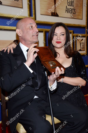 Stock Image of Sam Simon, left, poses in the press room with Jennifer Tilly with his Valentine Davies award at the Writers Guild Awards,, in Los Angeles