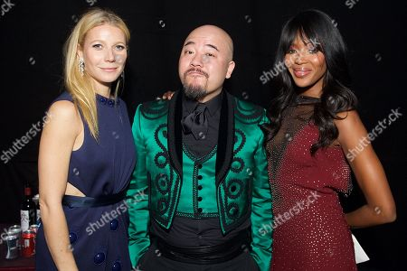 From left, Gwyneth Paltrow, Wyman Wong, and Naomi Campbell attend the inaugural amfAR Hong Kong gala on in Hong Kong