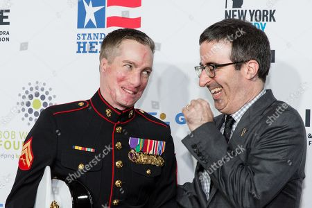 Marine corporal Aaron Mankin, left, and John Oliver appear at the 9th Annual Stand Up For Heroes, presented by the New York Comedy Festival and The Bob Woodruff Foundation, at the Theater at Madison Square Garden, in New York