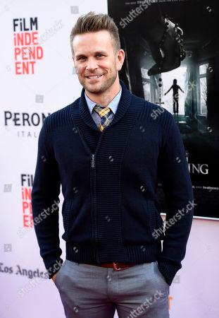 """John Brotherton, a cast member in """"The Conjuring 2,"""" poses at the premiere of the film during the Los Angeles Film Festival at the TCL Chinese Theatre, in Los Angeles"""