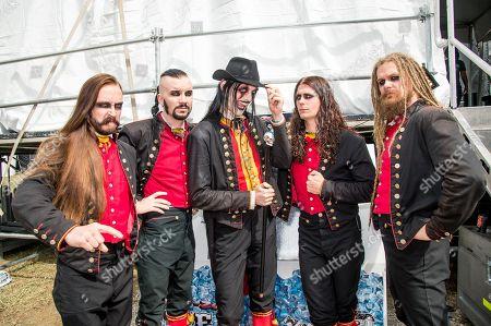 Jonas Kungen Jarlsby, from left, John Alfredsson, Johannes Eckerstrom, Henrik Sandelin, and Tim Ohrstrom of Avatar pose at the Louder Than Life Festival, in Louisville, Ky