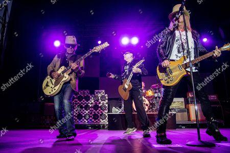 Tom Petersson, from left, Rick Nielsen, and Robin Zander of Cheap Trick perform at the Louder Than Life Festival, in Louisville, Ky