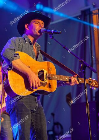 Sam Outlaw and band perform at the Pandora Discovery Den at the SXSW Station, during the South by Southwest Music Festival, in Austin, Texas