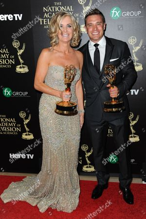 Eileen Davidson, winner of the award for outstanding lead actress in a drama series for Days of Our Lives, left, and Billy Miller, winner of the award for outstanding lead actor in a drama series for The Young and the Restless, pose in the press room at the 41st annual Daytime Emmy Awards at the Beverly Hilton Hotel, in Beverly Hills, Calif