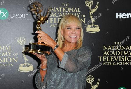 Linda Bell Blue poses in the press room with the award for outstanding entertainment news program for Entertainment Tonight at the 41st annual Daytime Emmy Awards at the Beverly Hilton Hotel, in Beverly Hills, Calif