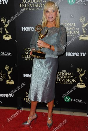 Stock Picture of Linda Bell Blue poses in the press room with the award for outstanding entertainment news program for Entertainment Tonight at the 41st annual Daytime Emmy Awards at the Beverly Hilton Hotel, in Beverly Hills, Calif