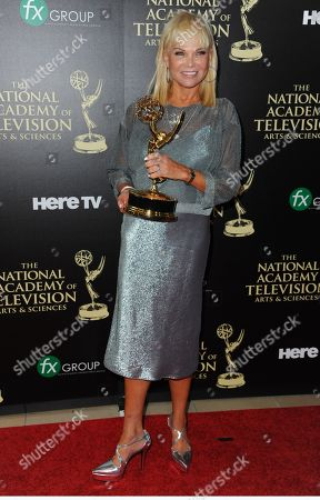 Linda Bell Blue poses in the press room with the award for outstanding entertainment news program for â?oeEntertainment Tonightâ?? at the 41st annual Daytime Emmy Awards at the Beverly Hilton Hotel, in Beverly Hills, Calif