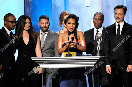 """From left, Columbus Short, Katie Lowes, Guillermo Díaz, Darby Stanchfield, Kerry Washington, Joe Morton, and Tony Goldwyn accept the award for outstanding drama series for """"Scandal"""" at the 45th NAACP Image Awards at the Pasadena Civic Auditorium, in Pasadena, Calif"""