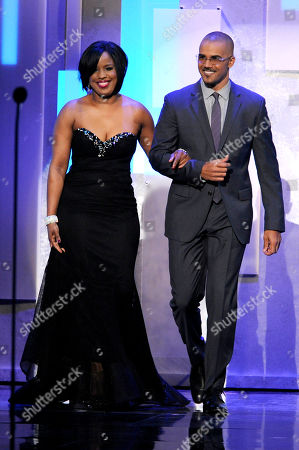 NAACP chairman Roslyn M. Brock, left, and Shemar Moore walk on stage at the 45th NAACP Image Awards at the Pasadena Civic Auditorium, in Pasadena, Calif