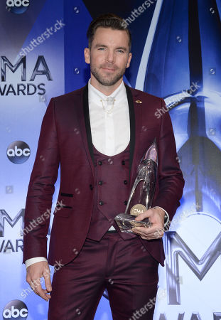 "Director TK McKamy, winner of the award for music video of the year for ""Girl In A Country Song,"" poses in the press room at the 49th annual CMA Awards at the Bridgestone Arena, in Nashville, Tenn"