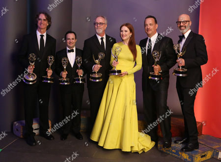 SEPTEMBER 23: (L-R) Director Jay Roach, writer Danny Strong, producer Gary Goetzman, actors Julianne Moore and Tom Hanks, and producer Steven Shareshian pose backstage at the Academy of Television Arts & Sciences 64th Primetime Emmy Awards at Nokia Theatre L.A. Live on in Los Angeles, California