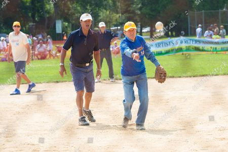 Mort Zuckerman pitches at the 66th Annual Artists and Writers Softball Game in East Hampton on in New York