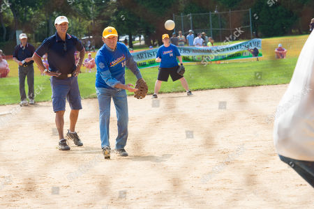 Stock Photo of Mort Zuckerman pitches at the 66th Annual Artists and Writers Softball Game in East Hampton on in New York