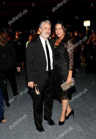 Stock Photo of Jon Stewart, left, and Tracey McShane attend the Governors Ball for the 67th Primetime Emmy Awards at the Los Angeles Convention Center, in Los Angeles
