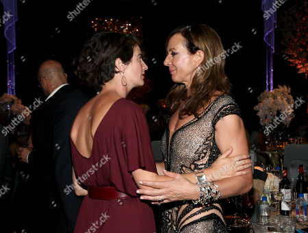 Stock Image of Gabby Hoffmann, left, and Allison Janney chat at the Governors Ball for the 67th Primetime Emmy Awards at the Los Angeles Convention Center, in Los Angeles