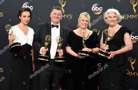 """Amanda Abbington, from left, Steve Moffat, Sue Vertue, and Rebecca Eaton pose in the press room with their awards for outstanding television movie for """"Sherlock: The Abominable Bride (Masterpiece)"""" at the 68th Primetime Emmy Awards, at the Microsoft Theater in Los Angeles"""