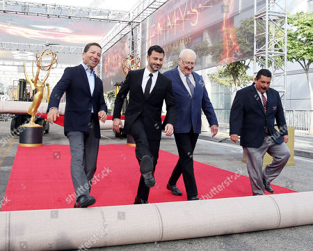 From left, Television Academy Chairman and CEO Bruce Rosenblum, host Jimmy Kimmel, producer Don Mischer, and Guillermo roll out the red carpet at the 68th Primetime Emmy Red Carpet Rollout and Governors Ball Reveal on in Los Angeles
