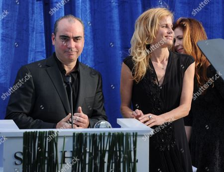"Jedd Wider, left, and Lori Singer accept a Television Academy Honors award for ""Mea Maxima Culpa: Silence in the House of God"" at the 7th annual Television Academy Honors presented by the Television Academy at the SLS Hotel, in Beverly Hills, Calif"