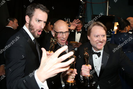 Chris Williams, from left, Roy Conli and Don Hall pose backstage with their award for best animated feature film for Big Hero 6 at the Oscars, at the Dolby Theatre in Los Angeles