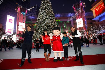 IMAGE DISTRIBUTED FOR AEG - From left, AEG's V.P. of Communications Michael Roth, Padres Contra El Cancer mascot Esperanza, 10 year old cancer survivor Leslie Maldonado and Stefano Langone attend the AEG Season of Giving honors Padres Contra El Cancer event on in Los Angeles