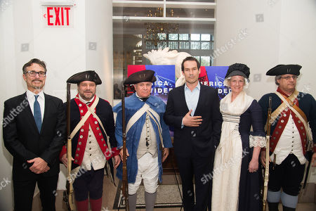 """Ian Kahn, center, and Barry Josephson, left, pose with Revolutionary War re-enactors at a premiere event for AMC's """"Turn: Washington's Spies"""" season three at the New York Historical Society, in New York"""