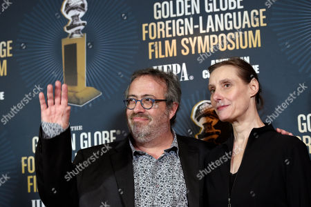 """Jaco Van Dormael, director of Golden Globe Best Foreign Language Film nominee """"The Brand New Testament"""" of Belgium/France/Luxembourg, poses alongside the film's choreographer Michelle Anne De Mey at the Golden Globe Foreign-Language Film Symposium at the Egyptian Theatre, in Los Angeles"""