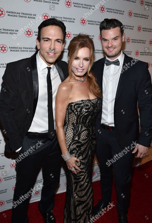 Dr. Bill Dorfman, and from left, Tracey E. Bregman and Austin Bregman attend American Friends of Magen David Adom's Red Star Ball held at The Beverly Hilton, in Beverly Hills, Calif