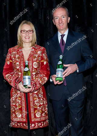 """Stock Image of Nicoletta Mantovani Pavarotti and CEO and President S.Pellegrino Stefano Agostini attend a preview of the exhibition """"AMO PAVAROTTI"""" in celebration of a new partnership between S.Pellegrino and the Luciano Pavarotti Foundation at 82MERCER, on in New York"""