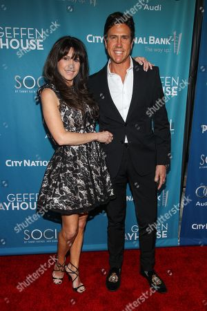 Stock Photo of Stacy Bell, left, and Nelson De La Nuez arrive at Backstage At The Geffen Gala, in Los Angeles